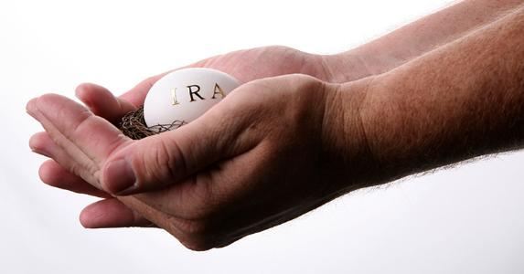 hands-carefully-holding-ira-egg-in-retirement-nest_573x300.jpg