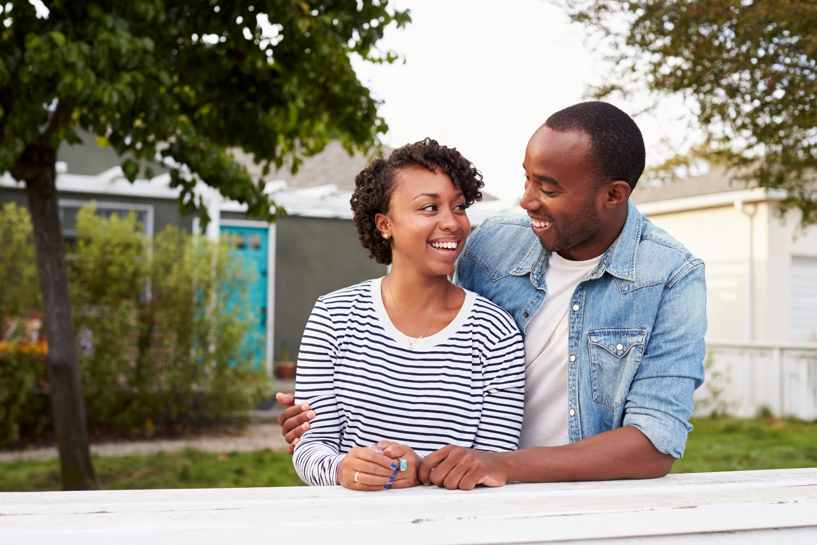 african-american-couple-outside-their-new-house-P3MVEDS-1