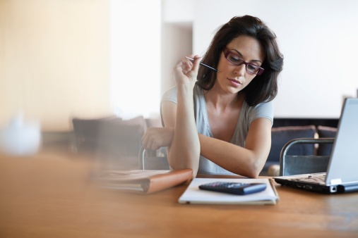 lady-sitting-looking-at-finances